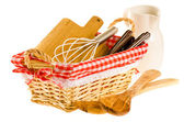 Kitchen tools in the basket, consisting of whisk, cutting board, — Stock Photo