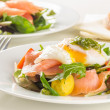 Stock Photo: Poached egg salad with smoked salmon, cherry tomatoes and pesto.