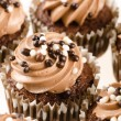 Chocolate cupcakes with chocolate icing and decoration isolated — Stock Photo