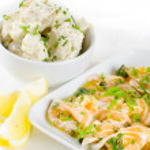 Salmon carpaccio (fresh salmon slices in marinade) with potato s — Stock Photo #24190567
