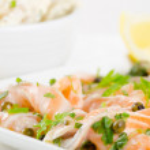 Salmon carpaccio (fresh salmon slices in marinade) — Stock Photo #24191023