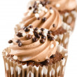 Chocolate cupcakes with chocolate icing and decoration isolated - Stock Photo