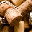 Stock Photo: Heap of champagne and wine corks as background.