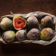 Figs in the box on wooden table — Stock Photo