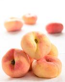 Fresh peaches on white the table. selective focus — Stock Photo