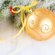 Christmas composition of fir--tree and golden bauble — Stock Photo #36792465