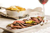 Slices of roast beef with potato gratin — Stock Photo