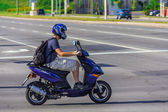 Man driving on a scooter — Stock Photo