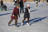 Two elder women ice skating — Stock Photo