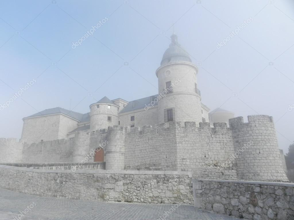Medieval castle in a foggy day. — Stock Photo #15224131