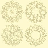 Set of 4 round decorative leaves compositions. — Stock Vector