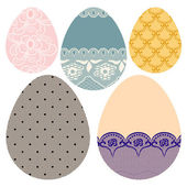 Set of lacy decorative Easter eggs. — Stock Vector