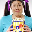 Fat young woman eating popcorn,young woman eating popcorn - Stock Photo