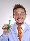 Funny young scientist holding an experimental tube. A doctor holding a glass tube. — Stock Photo