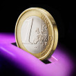 Piggy bank and one euro coin. - Stock Photo