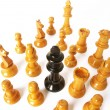 Foto Stock: Chess game over wood chart. Queen cornered.