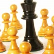 Chess game over wood chart.queen cornered. — Stock Photo