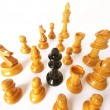 Chess game over wood chart. Queen cornered. — Stock Photo #13772825