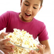 Little girl holding popcorn bowl. — Stock Photo