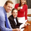 Business colleagues working in an office. — Stock Photo