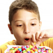 Little boy is eating candy — Stock Photo #13773298