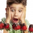 Close Up of a funny young boy - Stock Photo
