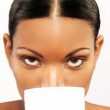 Beautiful latin young woman holding a white cup — Stock Photo