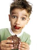 Close Up of Young Boy Eating A chocolate bar. — Stock Photo