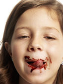 Little girl eating chocolate. — Stock Photo