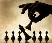 Playing chess game. defeating the Queen. — Stock Photo
