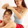 Caucasian young mother enjoying her daughter. - Stock Photo