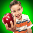 Little boy holding a fresh red apple. — Stock Photo