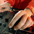 Detail of a disc jockey hands. — Stock Photo