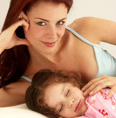 Caucasian young mother enjoying her daughter. — Stock Photo