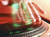 Detail of a disc jockey hands. — Stock Photo