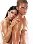 Portrait of a young undressed couple on white background. — Stock Photo