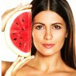 Young woman holding a fresh water melon — Stock Photo