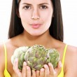 Young woman holding fresh artichoke — Stock Photo