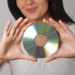 Hispanic woman portrait holding a compact disc — Stock Photo #13829753