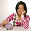 Stock Photo: Young woman and piggy bank saving money