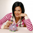 Royalty-Free Stock Photo: Young woman and piggy bank saving money