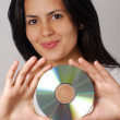 Royalty-Free Stock Photo: Hispanic woman portrait holding a compact disc