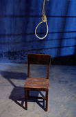 Hanged.rope and wood chair in a room. — Stock Photo