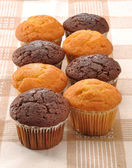 Group of chocolate and vanilla mini cakes — Foto de Stock