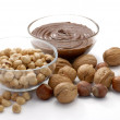 Chocolate nuts cream bowl and nut — Stock Photo #13843335