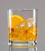 Exotic orange drink in glass — Stock Photo