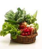 Assorted fresh vegetable basket on white background — Stock Photo