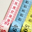Three measuring tapes detail - Stock Photo