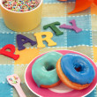 Colored dough nuts on a party table. — Stock Photo