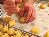 A cook prepares pastries — Stock Photo